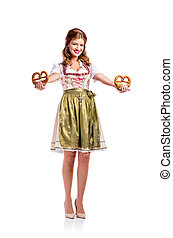 Beautiful woman in traditional bavarian dress holding pretzels