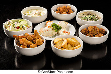 Mixed brazilian snacks, including pastries, fried chicken,...