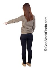 Back view of pointing woman. beautiful girl. Rear view...