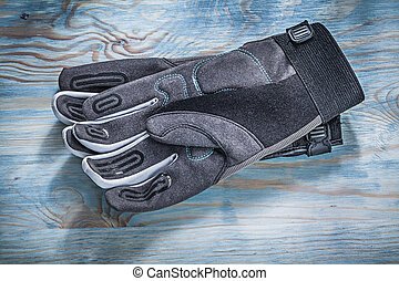 Safety gloves on wooden board directly above gardening...