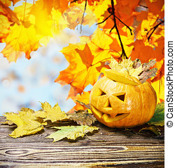 Jack Lantern for Halloween on wooden table on a background...