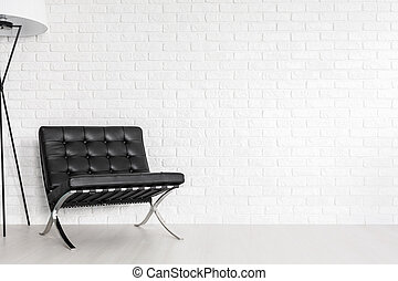 Modernist lounge seat in a post industrial interior - Black...