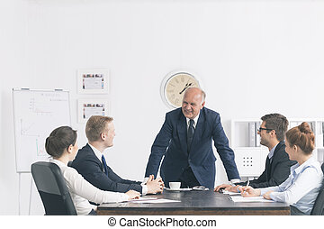 Corporate meeting with a relaxed boss - Bright office with...
