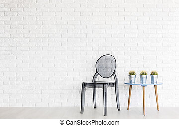 Transparent chair in a minimalist surrounding - Ghost chair...