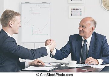 Satisfaction after signing a lucrative contract - Two...