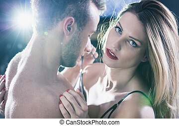 I don't love him - Unhappy sexy woman embracing a handsome...
