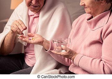 This medicines will help you - Senior woman holding glass of...