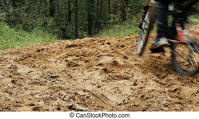 Teenager riding a bicycle in the woods. - Teenager riding a...