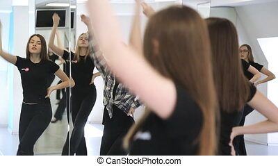 Girls actively move in dancing class on lesson of...