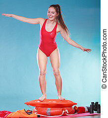 Happy lifeguard woman on rescue ring buoy. - Happy lifeguard...