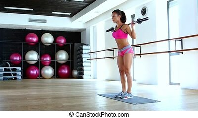 Girls does squats with weights - Girl squats in the gym,...