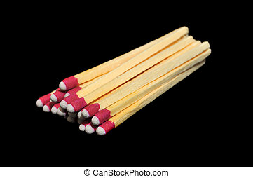 Pile of Matches Isolated on Black - A bunch of wooden...