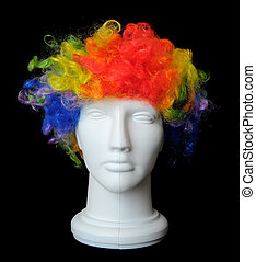Clown Wig on a Mannequin Head - A silly crazy man wearing a...