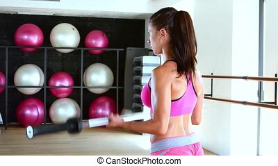Young woman making exercise at the gym - Athletic woman...