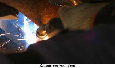 Welder Repairing Car Exhaust System Muffler - CLOSE UP shot...