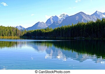 Temple Mountain reflection in Herbert Lake. - Banff National...