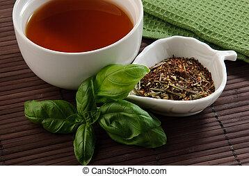 calming tea time - calming tea with tea leaves and tea towel...