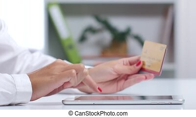 Girl enters data of three credit cards and completes online shopping. Close up