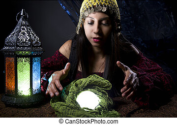 Fortune Teller Looking Into Crystal Ball - Woman dressed in...
