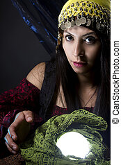 Astrology Fortune Teller with Crystal Ball - Woman dressed...