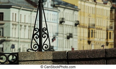 Cast iron forged lattice on a stone embankment, St....