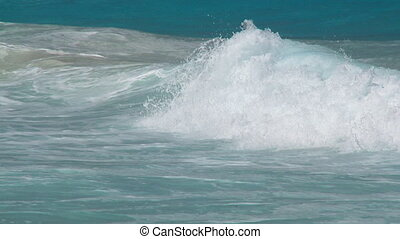 pan shot whitecaps to beach closeup slow motion - pan shot...
