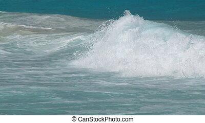 pan shot whitecaps to beach closeup slow motion
