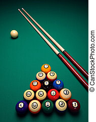 Cue sticks and Balls on a pool billard table before play