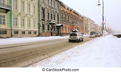 Cars driving along the old houses in St Petersburg, Russia