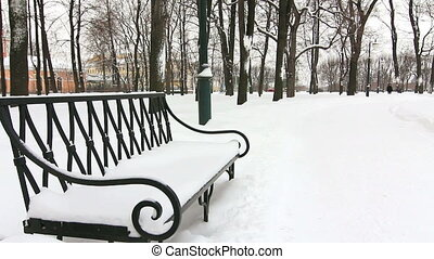 Seat in the alley in a winter park, StPetersburg, Russia
