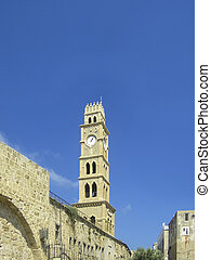old clock tower in harbor city of akko, Israel