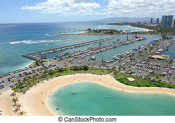 Looking out across the marina in Waikiki Beach, Hawaii in...