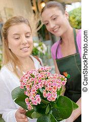 Florist holding a flower arrangement