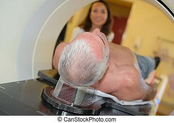man inside an MRI