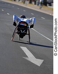 Single wheelchair athlete in action during a marathon.