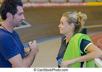 Sportswoman with coach