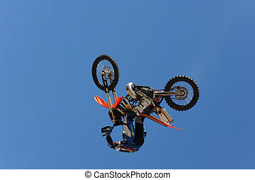 Motorbike Rider - A motorcycle rider getting air while doing...