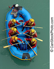 Aerial of photo white water rafters taking off