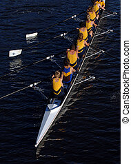 an aerial view of a rowing crew in action