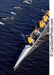 an aerial view of a rowing crew in action.