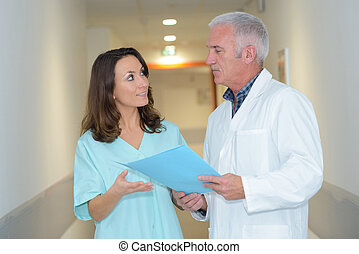 doctor and medical assistant having a conversation
