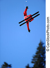 Ski Jump - A skier in a red suit gets air during a trick.