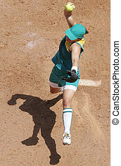 An aerial view of a female softball pitcher in action during a game.