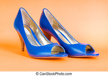 Fashion concept with blue woman shoes on high heels