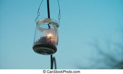 Glass Jar Candle Hanging on Arcch Slow Motion.