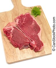 Raw T Bone Steak - A T Bone steak isolated against a white...