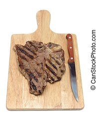 T Bone Steak - A T Bone steak on a cutting board isolated...