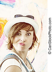 Crazy woman posing and pouting lips, warm photo filter -...