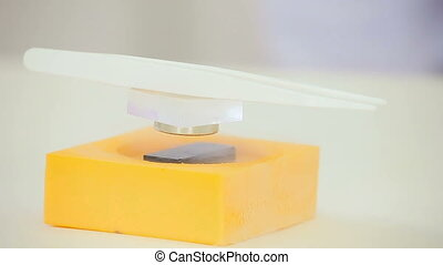 Physics in action, magnetic levitation experiment - Magnetic...