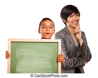 Hispanic Boy Holding Chalk Board and Female Teacher Behind...